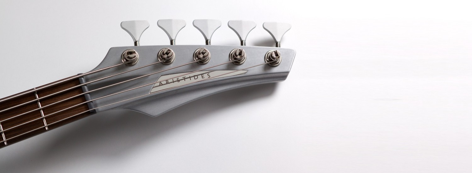 aristides bass 050 neck detail silver with chrome brand inlay